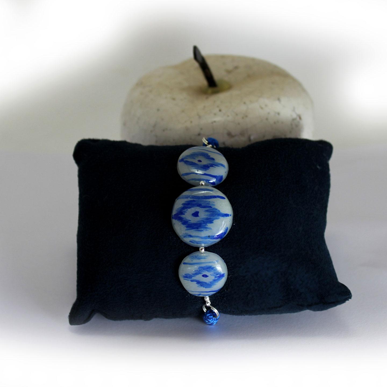 pulsera medallones lenguas mallorquinas en azul en bodegon